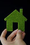 Eco house icon. Hand holding eco house icon Royalty Free Stock Photography