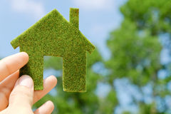 Eco house icon concept. Hand holding eco house icon concept Stock Photography