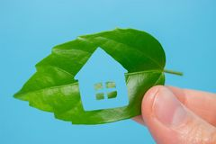 Eco house icon concept. House made from leaf Stock Photography