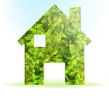 Eco house icon with green leaves Stock Image