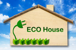 Eco house on Little home wooden model. Eco house on Little home wooden model on blue sky background. Save clipping path Stock Photo
