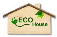 Eco house on Little home wooden model. Isolated on white background. Save clipping path Royalty Free Stock Images