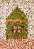 Eco house metaphor. From grain of bean, lentil, mash Stock Photos