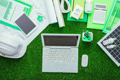 Eco house project. S, work tools and solar panel on the grass, laptop at center, green building and energy saving concept Stock Photography