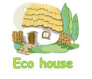 Eco hus med ett halmtäckt tak arkivbilder