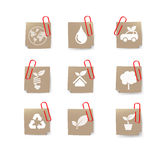 Eco icon on recycle paper and red clip on white Royalty Free Stock Image