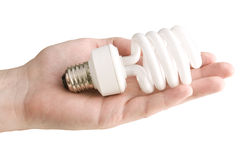 Eco lamp in his hand. On a white background Royalty Free Stock Image