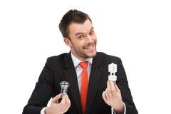 Eco lampa w ręce biznesowy mężczyzna Zdjęcia Stock