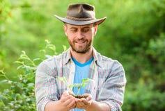 Eco-Landarbeiter Umweltslogans, Sprechen und Phrasen ?ber die Erde, die Natur und das gehende Gr?n Landwirtschaft und Landwirtsch lizenzfreie stockfotos