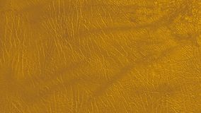 Eco leather amber-gold color texture. Up-close Stock Image