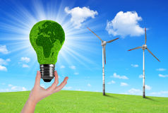 Eco Light bulb in hand Stock Photo
