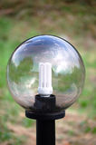 Eco light bulb into a street lamp Royalty Free Stock Photo