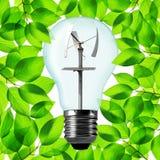 Eco light bulb with wind turbine. Royalty Free Stock Photo
