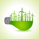 Eco light bulb with windmills Royalty Free Stock Image
