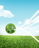 Eco living. Earth in the grass, recycle concept with lights Stock Photo