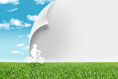 Eco living. Boy with a bicycle ecologic concept, change paper,sample your text Royalty Free Stock Photos