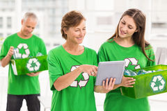 Eco-minded women with tablet and recycling box Stock Photo