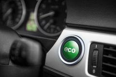 ECO mode button. Green ECO mode button on a dashboard of a sportive car Royalty Free Stock Image