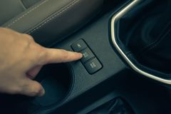ECO mode power mode button. Hand finger press button eco mode inside car stock photos