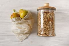 Eco natural bags with fruits and granola in glass, flat lay. plastic free items. reuse, reduce, recycle, refuse. bulk store. Sustainable lifestyle concept royalty free stock images