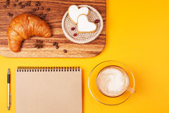 Eco notebook with cappucino Stock Photography