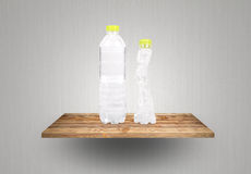 Eco plastic Bottles on wood shelf Royalty Free Stock Images