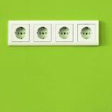Eco plug. Eco energy play on gree wall Royalty Free Stock Images
