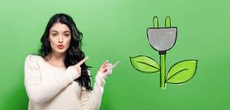 Eco Plug with young woman Stock Photos