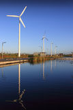 Eco Power Park. Wind turbines reflected in a parkland water way Stock Images