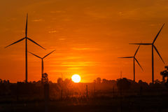 Eco power in wind turbine farm with sunset Stock Image