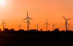Eco power in wind turbine farm with sunset Stock Images