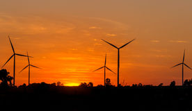 Eco power in wind turbine farm with sunset. Stock Photography