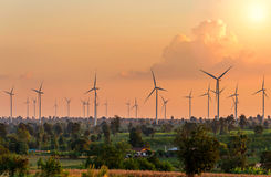 Eco power in wind turbine farm with sunset Stock Photo