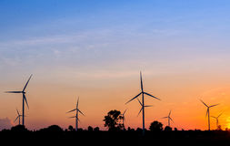 Eco power in wind turbine farm with sunset Royalty Free Stock Image