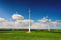 Eco power. Wind turbines generating electricity. Green environment. Spring sunny day on green field with wind power generators in Austria stock photos