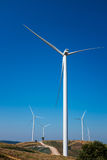 Eco power, wind turbines generating electricity, renewable energy source. Eco power, wind turbines generating electricity with clear blue sky background and stock photo