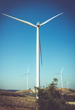 Eco power, wind turbines generating electricity, renewable energy source. Eco power, wind turbines generating electricity with clear blue sky background and stock image