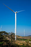 Eco power, wind turbines generating electricity, renewable energy source. Eco power, wind turbines generating electricity with clear blue sky background and royalty free stock image