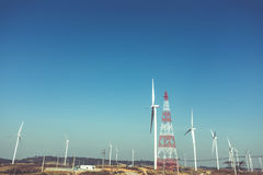 Eco power, wind turbines generating electricity, renewable energy source. Eco power, wind turbines generating electricity with clear blue sky background. Green stock images