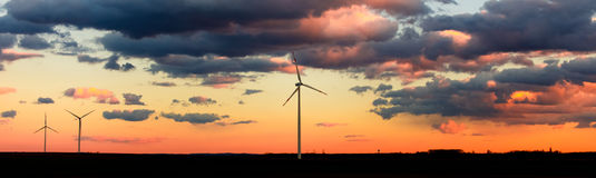 Eco power, wind turbines in sunset panorama Royalty Free Stock Photo