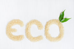 Eco rice cereals on a white background. With two green leaves Royalty Free Stock Images