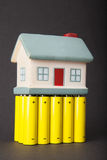 Eco-save home. On batteries AA Royalty Free Stock Images