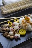Eco seafood on black plate Stock Photography
