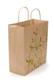 Eco shopping bag on white. Kraft shopping bag with reflection isolated on white background Royalty Free Stock Images