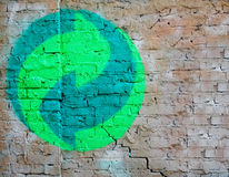 Eco sign on the brick wall . Concept Royalty Free Stock Images