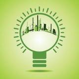 Eco-Stadt innerhalb einer grünen Glühlampe lizenzfreie abbildung