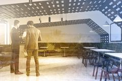 Eco style cafe interior business people. Eco style hipster cafe interior with a wooden and white walls and large windows. Flower beds as decorations. Business royalty free stock photo