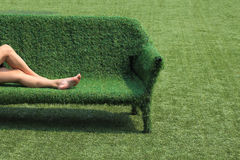 Eco style of interior decoration the grass sofa with green grass. Floor Royalty Free Stock Images