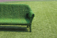 Eco style of interior decoration. The grass sofa with green grass floor Royalty Free Stock Photos