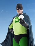 Eco superhero and CFL bulb Stock Photo